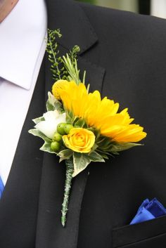Use as a corsage for the moms? Make the roses a purple flower. Can we turn the sunflower to see some of the face though?