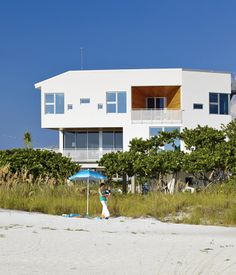 Architect Jody Beck with her son Jonah Tisdale, 1, in front of the family beach house she designed on Anna Maria Island, Florida. The hom...
