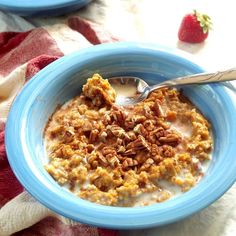 This rich and creamy sweet potato oatmeal is made my blending baked sweet potato with oats, along with a touch of cinnamon and pecans.