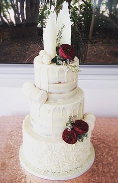 Semi naked beauty. White chocolate drizzle, white chocolate shards, white chocolate macaroons n truffles finish the look.