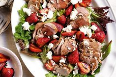 Strawberries are in season and they're an all round winner in this fresh pork salad.