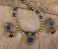 Handmade terracotta jewelry painted in blue  gold https://www.facebook.com/KavisTerracottajewellery