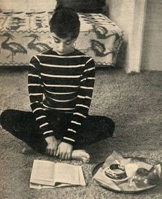 Audrey Hepburn with book and snack. The lady knew how to relax!