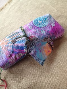 Inky scrap newspaper for gift wrap by Claire with inky scrap heart tag.