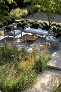 A cool contemporary garden with clean lines but softened with grasses.