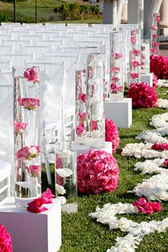 cylinders down the aisle on boxes can also be used as centerpieces later