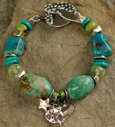 Dream Girls.....  Beautiful Fox Mine Turquoise from the old mine parades along side Gaspeite, AAA Prehnite, Peruvian Blue Opal and handcrafted sterling silver beads, charms and toggles.  Bracelet size is...........7.0 inches smaller than average!