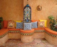 Colorful patio with cushions / pillows and peach stucco walls. - Colorful patio with cushions / pillows and peach stucco walls. Mexican Patio, Mexican Hacienda, Mexican Home Decor, Hacienda Style, Mexican Spanish, Spanish Tile, Spanish Colonial, Mexican Tiles, Spanish Style Decor
