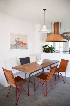 leather saddle dining chairs and copper range hood