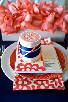 The perfect Coral and Navy place setting (Love this fabric.  Work into G&H's room?)