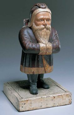 Artist unidentified  Northeastern United States  Late 19th century  Paint on wood  22 1/2 x 11 7/8 x 11 3/4 in.  American Folk Art Museum, promised gift of Ralph Esmerian, P1.2001.347  This stocky little Santa Claus presents a late nineteenth-century image of the venerable character that can be compared with Samuel Robb's version (also in the museum's collection) of around 1923.