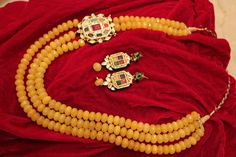 Navratan Pendant set with yellow beads with earings..