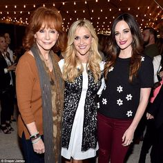 Stars and more stars: Here Reese stood between Reba McEntire and Kacey Musgraves, which sh...