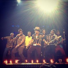 Bruno Mars-Moonshine is one of my favorite songs right now-just got his cd and love it!!
