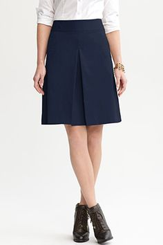 A-Line Skirt  Navy's partner in crime is usually Mr. White, Mr. Tan or the always popular Mr. Gray, but this season pair it with chartreuse, pink and even black tops and accessories for a more modern take. Added bonus: The A-line shape is flattering on almost every body type.