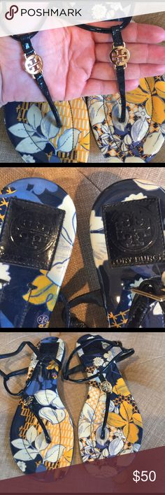 Pre loved Tory Burch Sandals size 8.5 Floral blue, white and yellow design with dark blue patent leather strap and gold TB medallion. These are in great condition! Still have more miles on them :) Tory Burch Shoes Sandals
