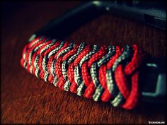 https://flic.kr/p/GR8DuB | carabiner pineapple wrap | Red Type I/#95 paracord and black/gray 2mm cord used for this pineapple knot on a carabiner, TAC LINK style.