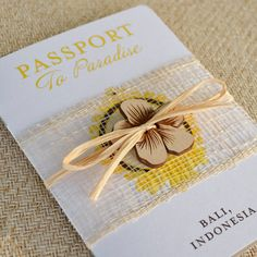 Indonesian Hibiscus Flower Passport Wedding Invitation -- the cute details (raffia tie, sinamay wrap and wooden embellishment) make this invite one of a kind
