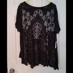 """Free People Graphic Circle in the Sand Top This tee is NWT! It is a washed, faded black color. It has a white design on the front. It is a oversized hi low top. It is approximately 29"""" across the bust when laid flat. It is approximately 22"""" from shoulder to hem at the shortest point and 32"""" at the longest point. It is 52% linen, 48% cotton. Free People Tops"""