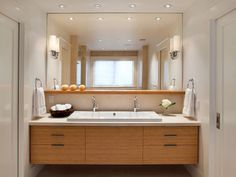 Love one big sink with 2 faucets, sconces on mirror, pinhole lighting Linda-Sullivan-neutral-contemporary-bathroom-vanity_s4x3_lg