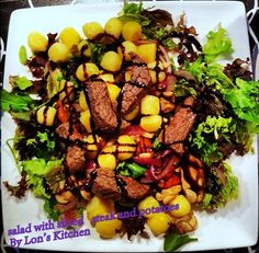 Salad with sliced steak and potatoes and mushrooms