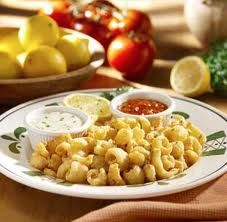 Olive Garden's Calamari....white dipping sauce!       The recipe for Olive Garden's peppercorn sauce is:  1/2 c mayonnaise  2 tsp freshly ground black pepper  3/4 c buttermilk  1 tsp garlic  1/2 tsp cayenne pepper  1 tsp onion powder  Put all the ingredients in a bowl and mix well. Cool before using.
