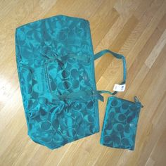"""COACH Packable Tote & Cosmetic Bag NEW Listing - Brand New Coach LARGE Packable tote with snap in cosmetic bag.  Color is called Jade Green.  Tote measures 24"""" wide x 14"""" high and 8"""" deep.  Cosmetic bag measures 10.5"""" wide x 8.5"""" high.  Great overnight or weekender bag .  Color is absolutely amazing .  Color is most accurate on strap photo (second photo)  Selling for a friend.  Smoke and pet free home.  No PP or trades.  Will consider REASONABLE offers!! Coach Bags Totes"""
