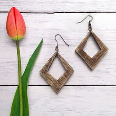 Wood Earrings - Diamond  These Wood Earrings have a worn, rustic look that pair perfectly with your favorite T-shirt and Jeans. Minimal earring