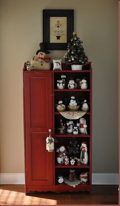 I want this cabinet! and possibly all the snowmen!