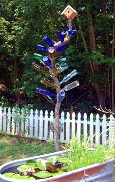 Bottle Trees N Marble Trees Slideshow by sangaree_KS Wine Bottle Trees, Wine Bottle Art, Wine Bottle Crafts, Blue Bottle, Jar Crafts, Glass Bottle, Wine Bottles, Bottle Garden, Glass Garden
