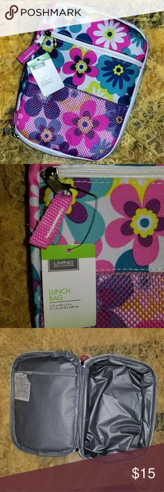 🌸NEW🌸 Flower Power Lunch box New with tags for your flower power princess or the inner hippie inside you. Go to lunch looking retro in this lunch box. Has net pouch on the front and on the inside. Also has a zipper pocket in the front. Zips closed to a silver insulated box. Pink handle for easy carry. White w pink, purple blue and yellow floral print. Easy to clean. Accessories