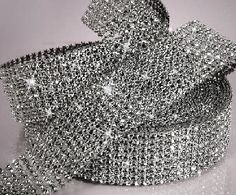 This is how they do a lot of the BLING !!!!      I sell this bling.  It looks great on so many items - bouquet wrap, cake stands, candles, guest book, pen, shoes, toasting goblets, etc.