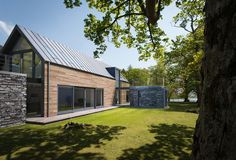 I love this barn for its reference to barn, but in a very contemporary way