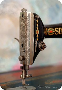 antique Singer sewing machine , this is what I learned to sew on .