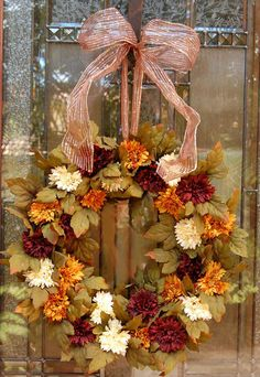Autumn Wreath...you can almost hear the leaves crunching under your feet, looking at this wreath...I love the colors...no tutorial...but the photo is pretty good for reference use