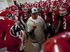 Port Huron defensive coordinator Dave Tatti talks with players in the locker room before a football game August 29, 2014 at Port Huron High School.
