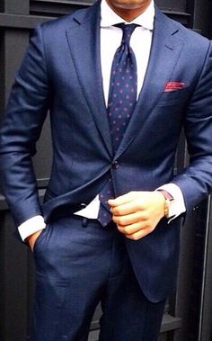 Blue suit, blue tie with red polka dots, and a red pocket square. Where would you wear this look? #Style