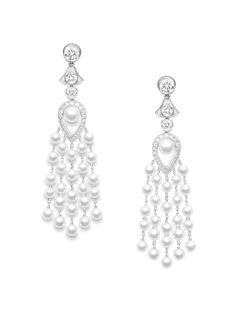 Piaget Earrings in 18K white gold set with 52 brilliant-cut diamonds, 2 pear-shaped diamonds and 52 white pearls.