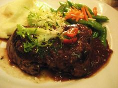 Steak Diane w/ mashed potatoes & vegetable of the day at Harris