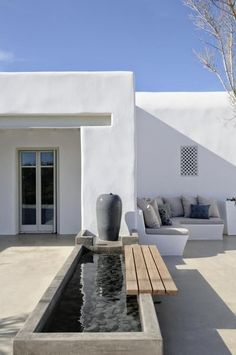 Raised pond and built-in bench pool backyard Luxury villa escape to the sultry island of Paros