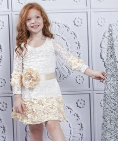 Resplendent with roses and lovely lace, this frock wraps dainty darlings in a bouquet of bright charm. Crafted with a hint of stretch for comfort and topped with a gleaming sash, it's perfect for a little lady whose sense of style is beginning to bloom.