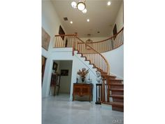 Grand covered entrance with two-story marble foyer and circular staircase -- Stamford, CT 06831 - #: 99046099