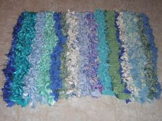 Made this hooked rug from recycled bits  of cloth.......I wanted it in blues to look  like the sea.