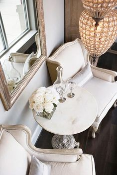 Chic sitting space with Eloquence Louis Philippe Silver Mirror, French marble top accent table and pair of French wingback chairs.
