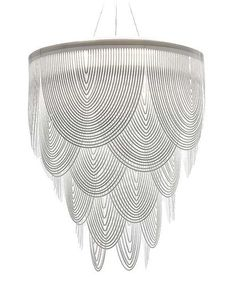 The Ceremony chandelierby Slampwas designed by Bruno Rainaldi.This contemporary chandelieris made from an opalflex material. The Ceremony chandelier is made up of white swags of opalflex which lets thelight illuminate through the openings creating a diffused and direct light.