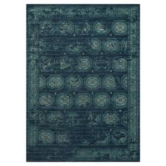 Anchor your living room seating group or define space in the den with this loomed wool and art silk rug, featuring a Persian-inspired medallion motif for tim...