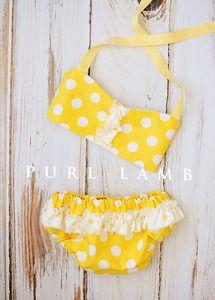 She wore a itsy bitsy, teeny tiny, yellow polka dot bikini .... size 6-12 months. Super cute PHOTO PROP