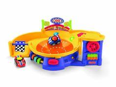 Fisher-Price Lil' Zoomers Spinnin' Sounds Speedway  ~1800  Крутейшая свето-музыкальная штука! Когда шажимаешь на рычаг, то штука внутри начинает крутиться и машинку выбрасывает под действием центробежной силы. В комплекте 2 машинки.