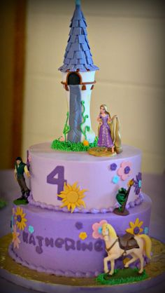 Rapunzel cake, buttercream with fondant accents, handmade tower, and figurines.