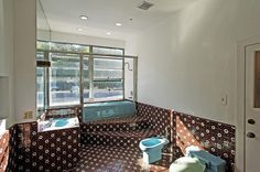 Another bathroom is filled with bold patterned tiling.   Stop Everything and Tour Jared Leto's New $5 Million Military Compound   POPSUGAR Home